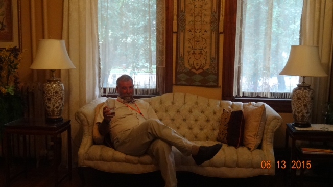 Hubster relaxing in fancy living room at Iron Gate B & B.