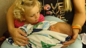 Chooch holding newest grandchild. She loved holding her cousin.